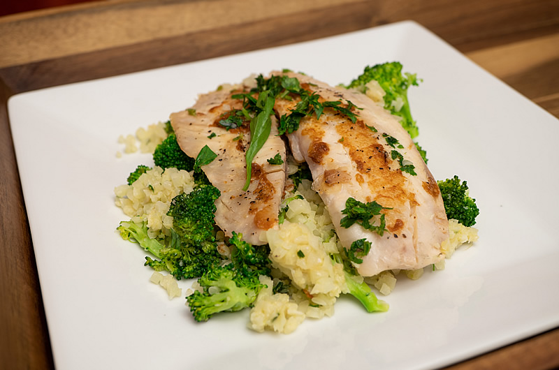 Cauliflower rice with fish - enhanced with Smarter Naturally ™ soup sauce